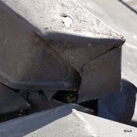 Roofing cap in need of repairs