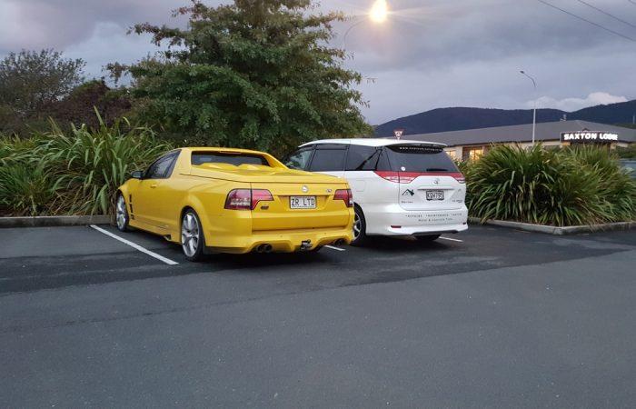 yellow holden ute and white family wagon